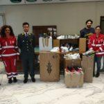 La Guardia di Finanza dona alla Croce Rossa Italiana oltre duecento paia di scarpe